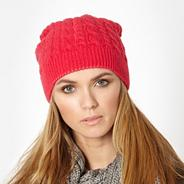Bright pink cable knit beanie hat