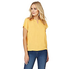 The Collection - Yellow cut-out neck bubble hem top