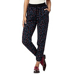 H! by Henry Holland - Designer black heart daisy print trousers