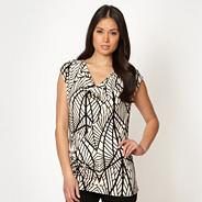 Designer black graphic leaf cowl top