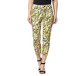 Principles Petite by Ben de Lisi - Designer bright yellow hibiscus print trousers