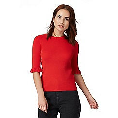 Red Herring - Red ruffle sleeve jumper