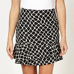 Red Herring - Black giraffe patterned frilly skirt