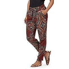 Red Herring - Terracotta african print woven trousers