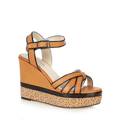 Red Herring - Tan punched daisy wedge sandals