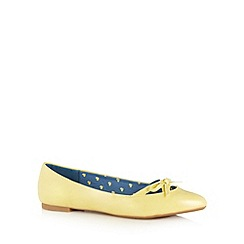 Red Herring - Light yellow patent cutout bow pumps