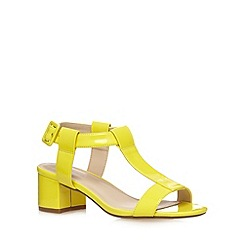 Red Herring - Yellow buckle mid sandals