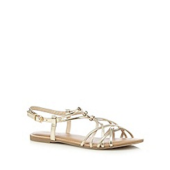 Red Herring - Gold flat overlapping strap detail flat sandals