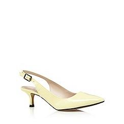 Clarks - Yellow 'Aquifer Belle' mid court shoes