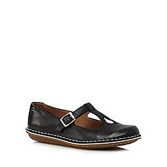 Clarks - Black cutout flat shoes