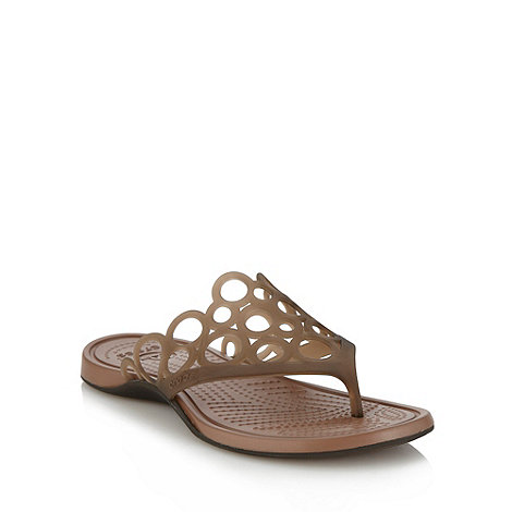 Crocs - Brown cut out circle flip flops