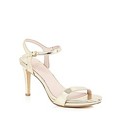 Faith - Gold 'Libertine' patent high sandals