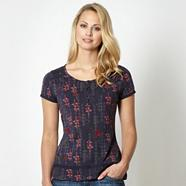 Navy floral embroidered button top