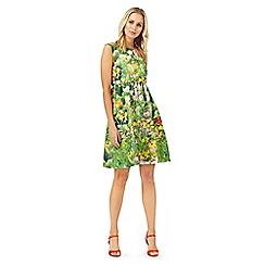 Racing Green - Green floral print knee length skater dress