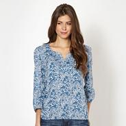 Blue floral stitched V neck top