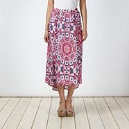 Pink tribal printed dipped hem skirt
