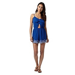 Floozie by Frost French - Blue crepe cutout bow front playsuit