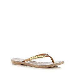 Grendha - Gold bar detail animal flip flops