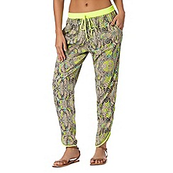 Butterfly by Matthew Williamson - Designer lime reptile print trousers