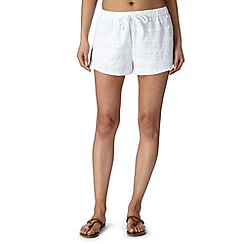 Iris & Edie - White heart woven beach shorts