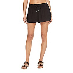 Beach Collection - Black cut-out flippy shorts