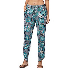 Beach Collection - Navy floral print trousers
