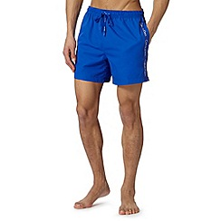 Calvin Klein - Bright blue logo tape swim shorts