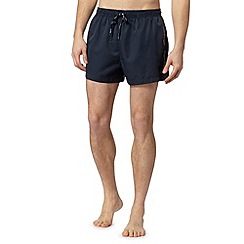 Calvin Klein - Navy logo tape side swim shorts