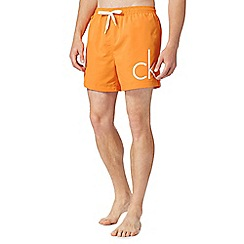 Calvin Klein - Orange logo swim shorts