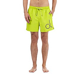 Calvin Klein - Lime logo print shorts
