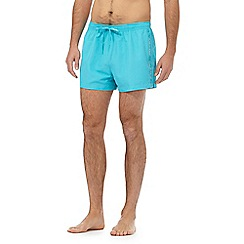 Calvin Klein - Turquoise logo tape swim shorts