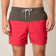 Red cut and sew swim shorts