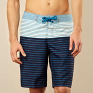 Navy graduated striped swim shorts