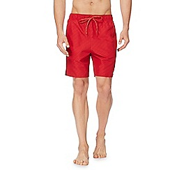 Nike - Red printed logo swim shorts