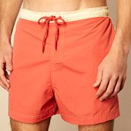 Dark orange cut and sew swim shorts