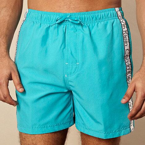 Calvin Klein - Turquoise logo tape striped swim shorts