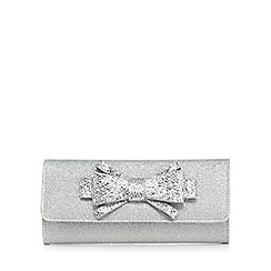 Debut - Silver glittery bow clutch bag