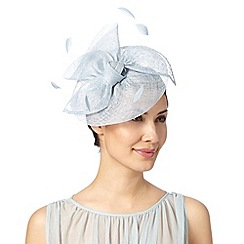Debut - Pale blue polka dot bow feather disc fascinator