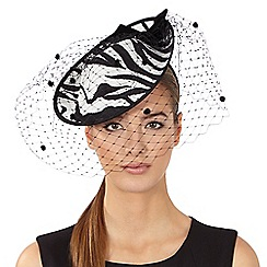 Top Hat by Stephen Jones - Black zebra print saucer fascinator with netting