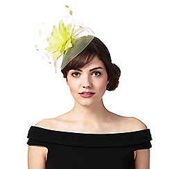 Principles by Ben de Lisi - Light yellow feather flower fascinator