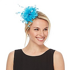 Debut - Turquoise feather headband fascinator