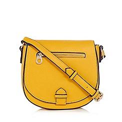 Red Herring - Yellow cross body saddle bag