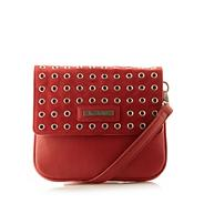 Designer red eyelet studded cross body bag