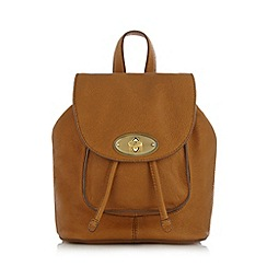 Mantaray - Light tan leather twist lock mini backpack