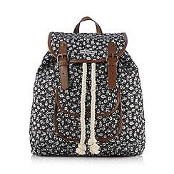 Iris & Edie - Black floral print backpack
