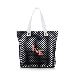 Iris & Edie - Navy spotted shopper bag
