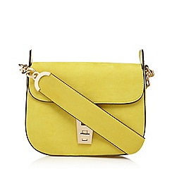 Red Herring - Lime green metal fitting cross body bag