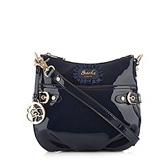 Sacha - Navy patent rose charm cross body bag