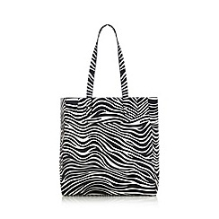 Red Herring - Near lack zebra shopper bag