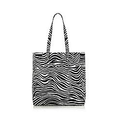 Red Herring - Near lack zebra shopper bag